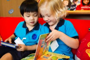 A picture of ESF kindergarten students reading a book