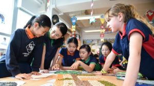 A picture of happy ESF Quarry Bay School students in class